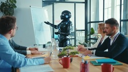 Office worker cyborg presenting speech in corporate boardroom. Business people and robot discussing strategies and future technologies on meeting.