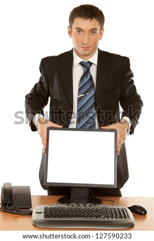 Office worker holding blank computer monitor with clipping path for the screen isolated on white