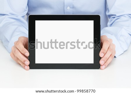 Office worker holding blank digital tablet with clipping path for the screen