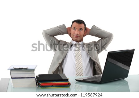 Office worker stretching at his desk