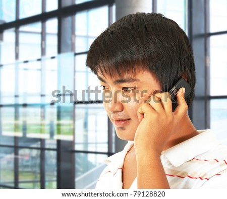 Office Worker Talking On The Phone In Front Of Many Windows