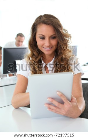 Office worker using electronic tablet in office