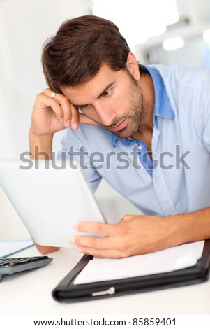Office worker using tablet at work