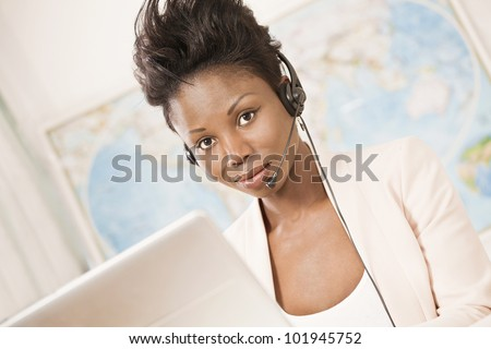 Office worker with headset in busy office