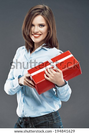 Office worker woman hold red gift. Smiling young business woman.