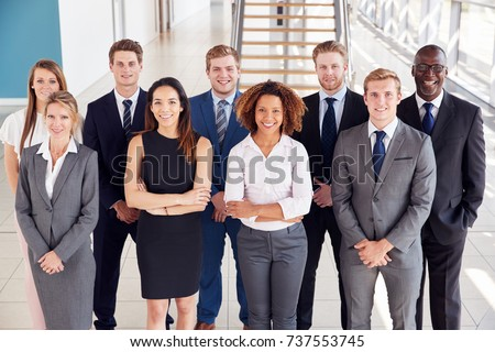 Office workers in a modern lobby, group portrait