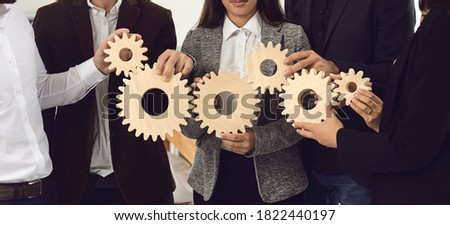 Office workers joining cogwheels into working system. Concept of effective business management, collaboration, teamwork and taking responsibility. Banner, header, hero image for company website design