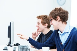 office workers looking at something interesting and funny