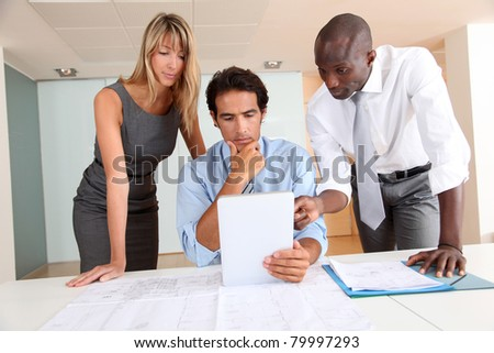 Office workers meeting with electronic tablet