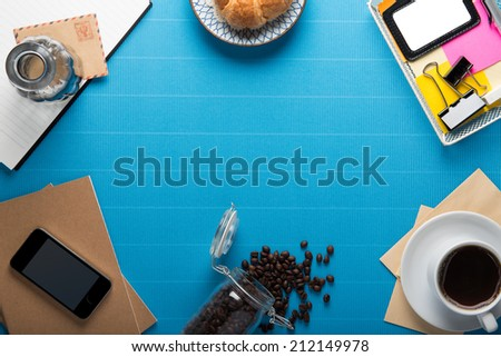 Office workplace,office Equipment and coffee break on blue crepe paper desk
