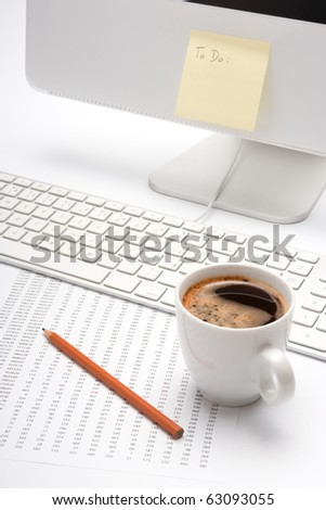 Office workplace with coffee, pencil, sheet with numbers, keyboard and blank To do list on computer