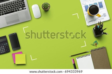 Office workplace with laptop, notebook, office supplies and stationery on green background. Solution, business planning, data analysis, creative, design, start, or working flat lay top view concept.