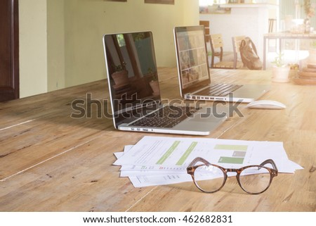 Office workplace with laptop with document statistics and glasses wood table #462682831