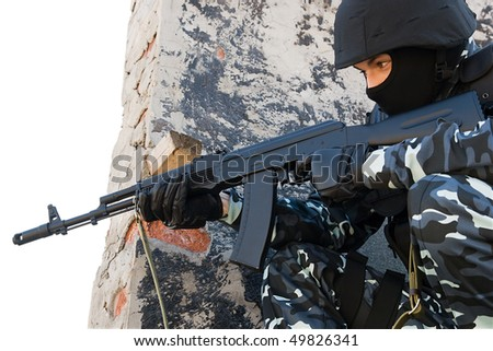 Officer in full ammunition targeting with automatic russian AK47 rifle