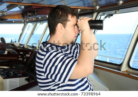 officer on the watch on bridge of modern ship