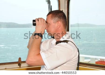 officer on watch on navigation bridge