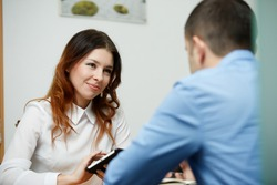 Officeworkers discuss topic with tablet