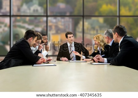 Official people sitting and talking. Midday conference in company's headquarters. Best employees of analytical department. Time for the next step. #407345635