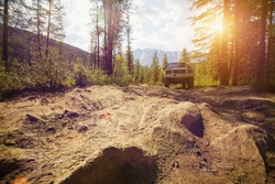 Offroad in wild mountains. Large rocks on the road, extreme travel adventure in nature