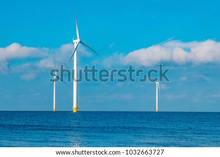 Offshore and Onshore Windmill farm in the ocean  Westermeerwind park , windmills isolated  on a beautiful bright day Netherlands Flevoland Noordoostpolder  #1032663727