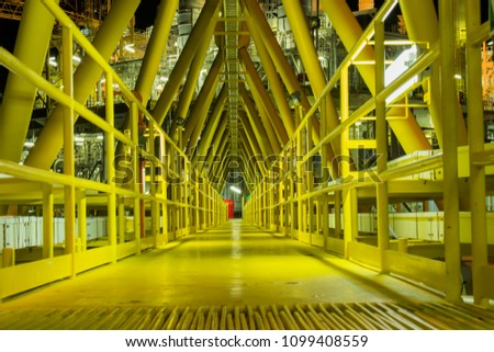 Offshore bridge between production platform and living platform on night time. #1099408559