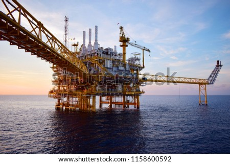Offshore construction platform for production oil and gas. Oil and gas industry and hard work.