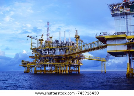 Offshore construction platform for production oil and gas, Oil and gas industry and hard work, Production platform and operation process and gas industry.