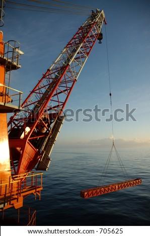 Offshore crane lifting a 13 meter basket