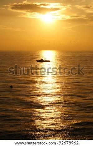 Offshore Crew Boat Before Sunset (Golden Sky)
