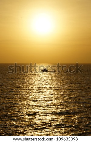 Offshore Crew Boat for Crew Change Before Sunset With Stunning Golden Sky