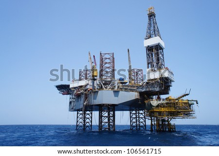 Offshore Jack Up Drilling Rig and The Production Platform in The Middle of The Sea