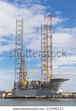 Offshore Jack Up Drilling Rig in the harbour - stock photo