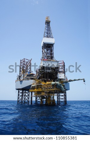 Offshore Jack Up Drilling Rig Over The Top of Oil and Gas Production Platform