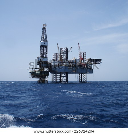 Offshore Jack Up Oil Drilling Rig and The Production Platform in The Middle of The Ocean Working For Petroleum Development Project