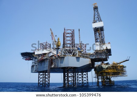 Offshore Jack Up Rig and The Production Platform in The Middle of The Sea