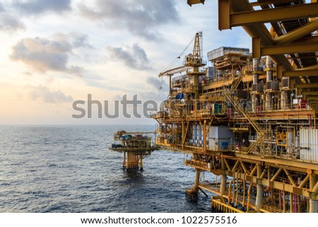 Offshore oil and Gas central processing platform and remote platform produced oil, natural gas and liquid condensate for set to onshore refinery from offshore in ocean sea background. #1022575516