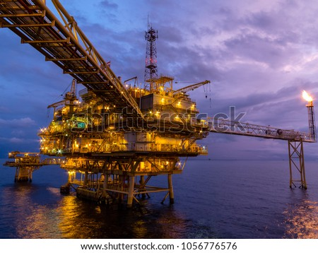 Offshore oil and Gas central processing platform and remote platform produced oil, natural gas and liquid condensate for set to onshore refinery from offshore in ocean sea background.