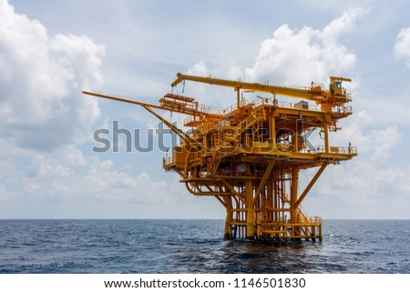 Offshore oil and Gas central processing platform and remote platform produced oil, natural gas and liquid condensate for set to onshore refinery from offshore in ocean sea background. #1146501830