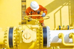 Offshore oil and gas operations, production operator open valve to allow gases flowing to sea line pipe for sent gas crude oil to central processing platform, oil and gas maintenance and service work.