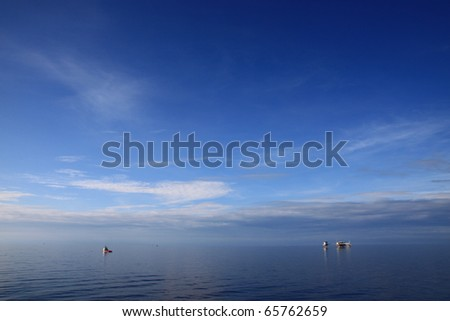 Offshore Oil and Gas Production Facility on Sunny Day with Blue Sky