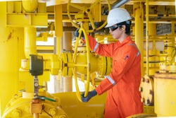 Offshore oil and gas site service operator open valve for control gas and crude oil product at central processing platform, Petroleum and chemical industry business.