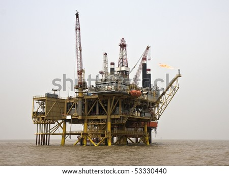 Offshore oil production facility view from the supply boat on a foggy day