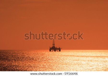 Offshore oil rig during sunset  in Caspian sea - more similar photos in my portfolio