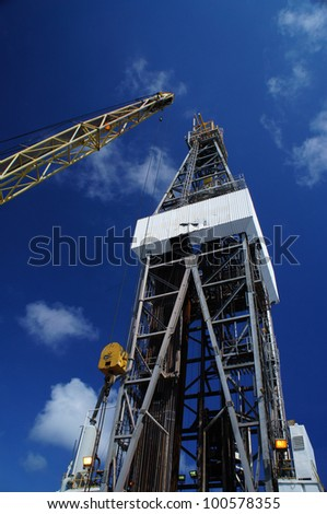 Offshore Oil Rig (Jack Up Rig) and Rig Crane with Blue Sky