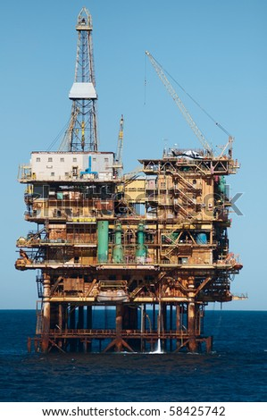Offshore oil rig with helicopter landed.  Coast of Brazil