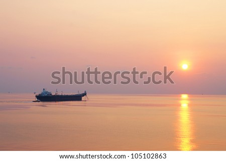 Offshore Oil Tanker and Small Crew Boat in The Offshore Oil and Gas Production Field at Sunset Time