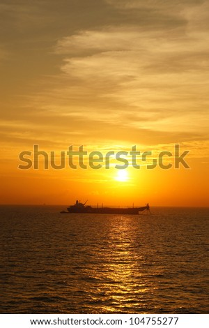 Offshore Oil Tanker in The Middle of The Ocean at Sunset Time