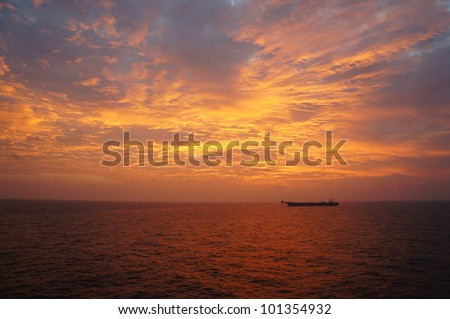 Offshore Oil Tanker in The Middle of The Sea at Sunset Time