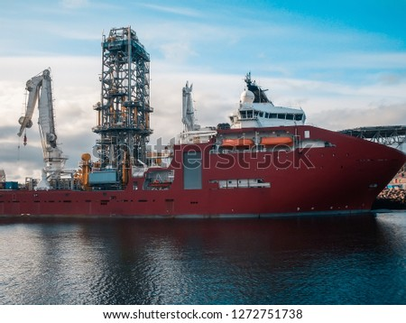 Offshore seismic vessel or ship for searching oil in port. Oil Rig and crane on background #1272751738