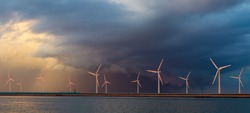Offshore wind farm at beautiful, dramatic sunset